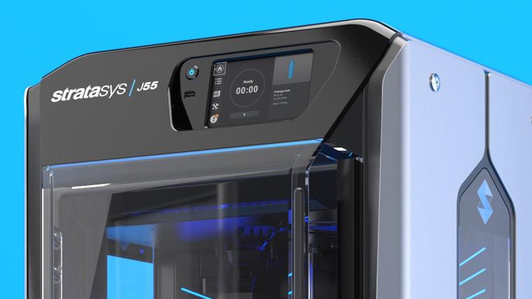 Stratasys 3D printer on a blue background.