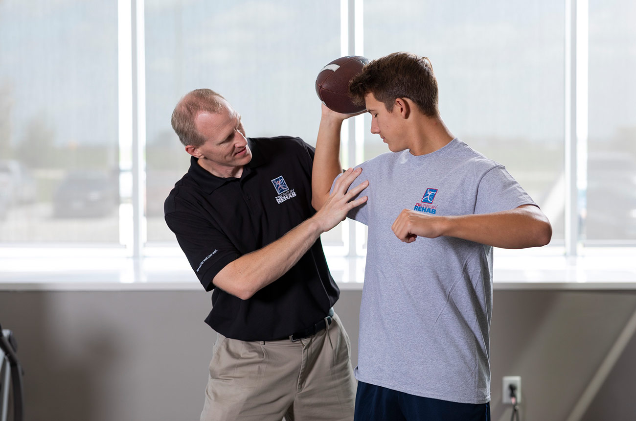 football player doing physical therapy