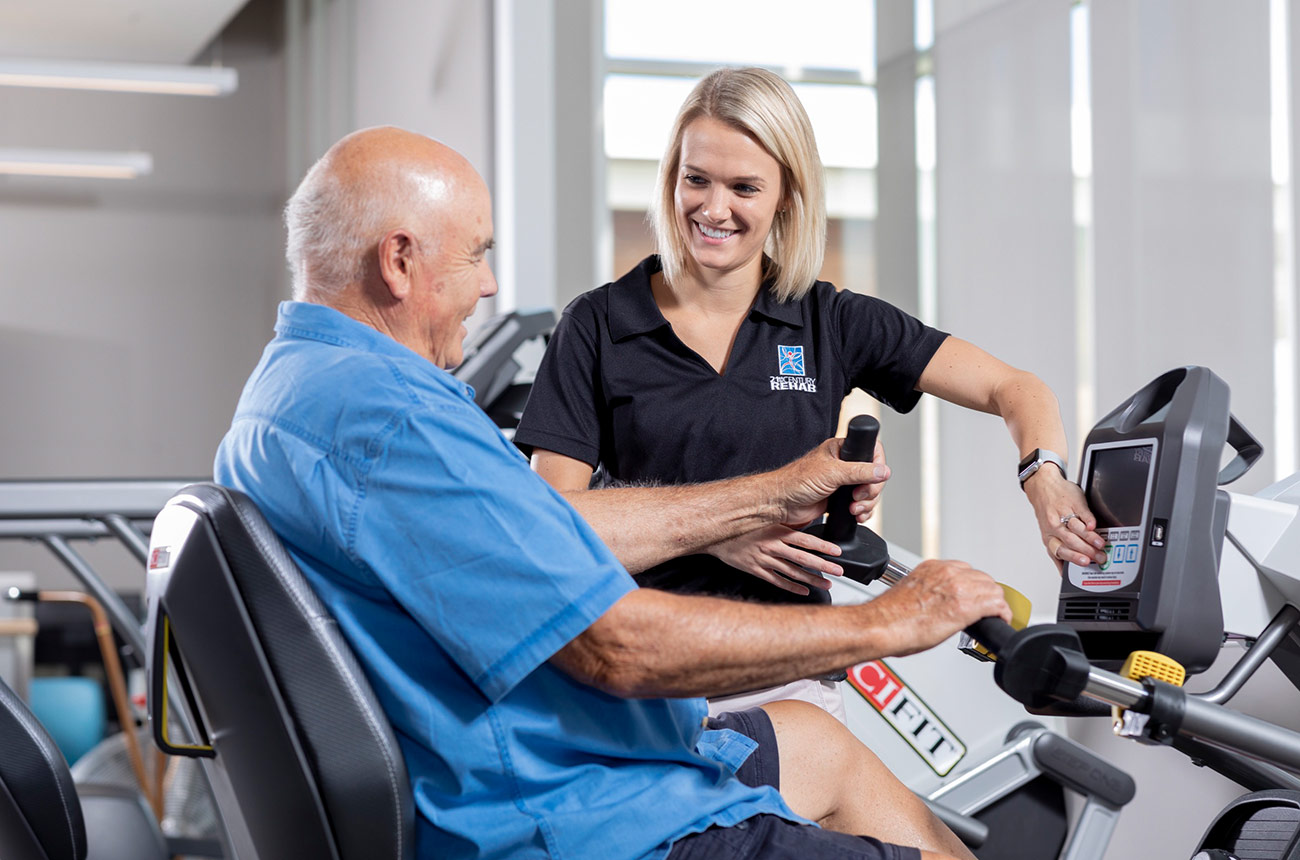 older man doing physical therapy