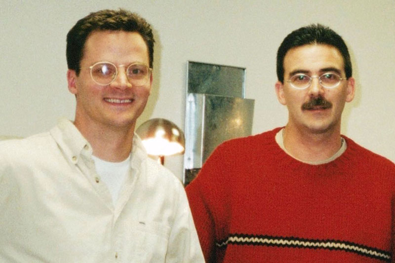 Two men with glasses, Jeff and Jim, smiling and standing side by side.