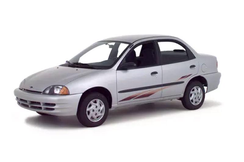 Silver 2000 Geo Metro Hatchback.