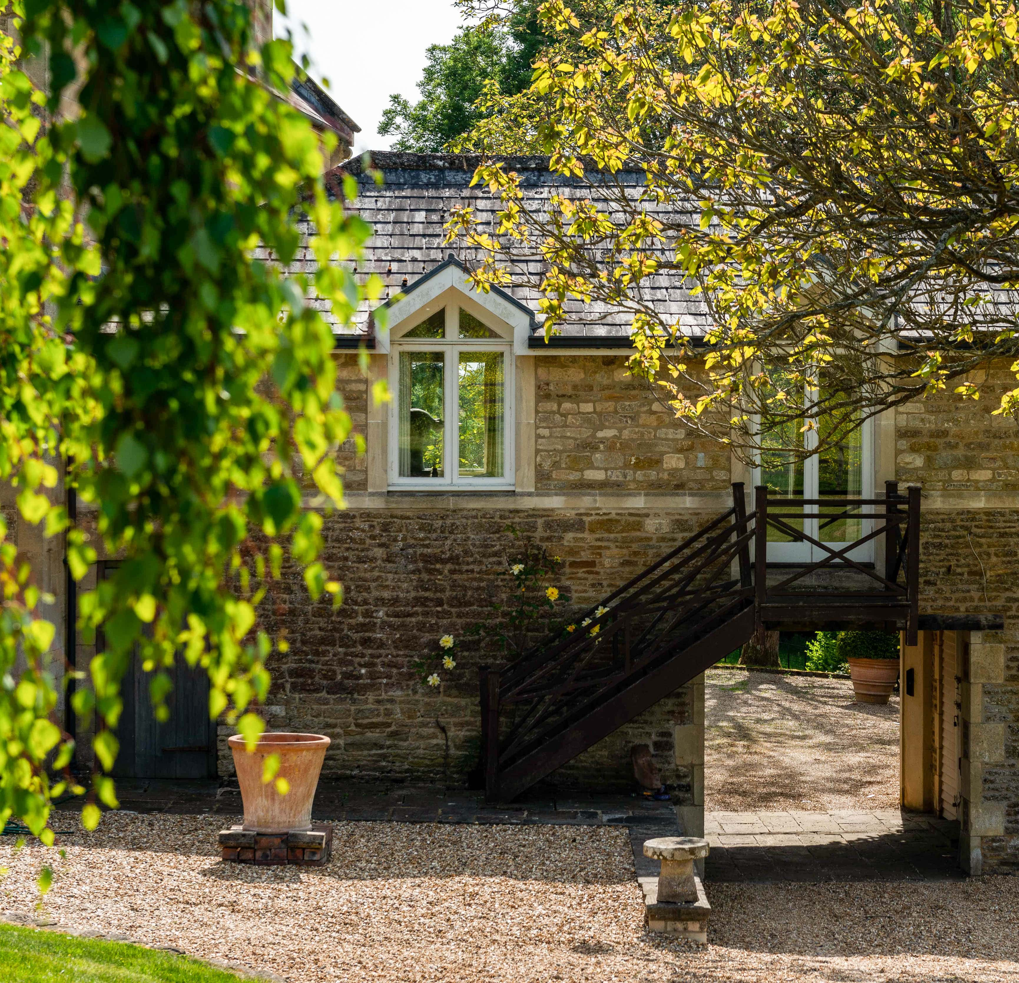 A beautiful country home courtyard framed by foliage