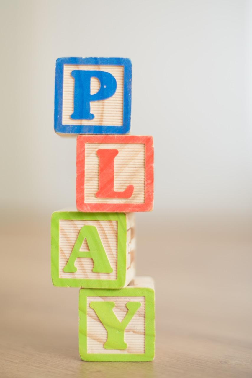 Wooden building blocks spelling play