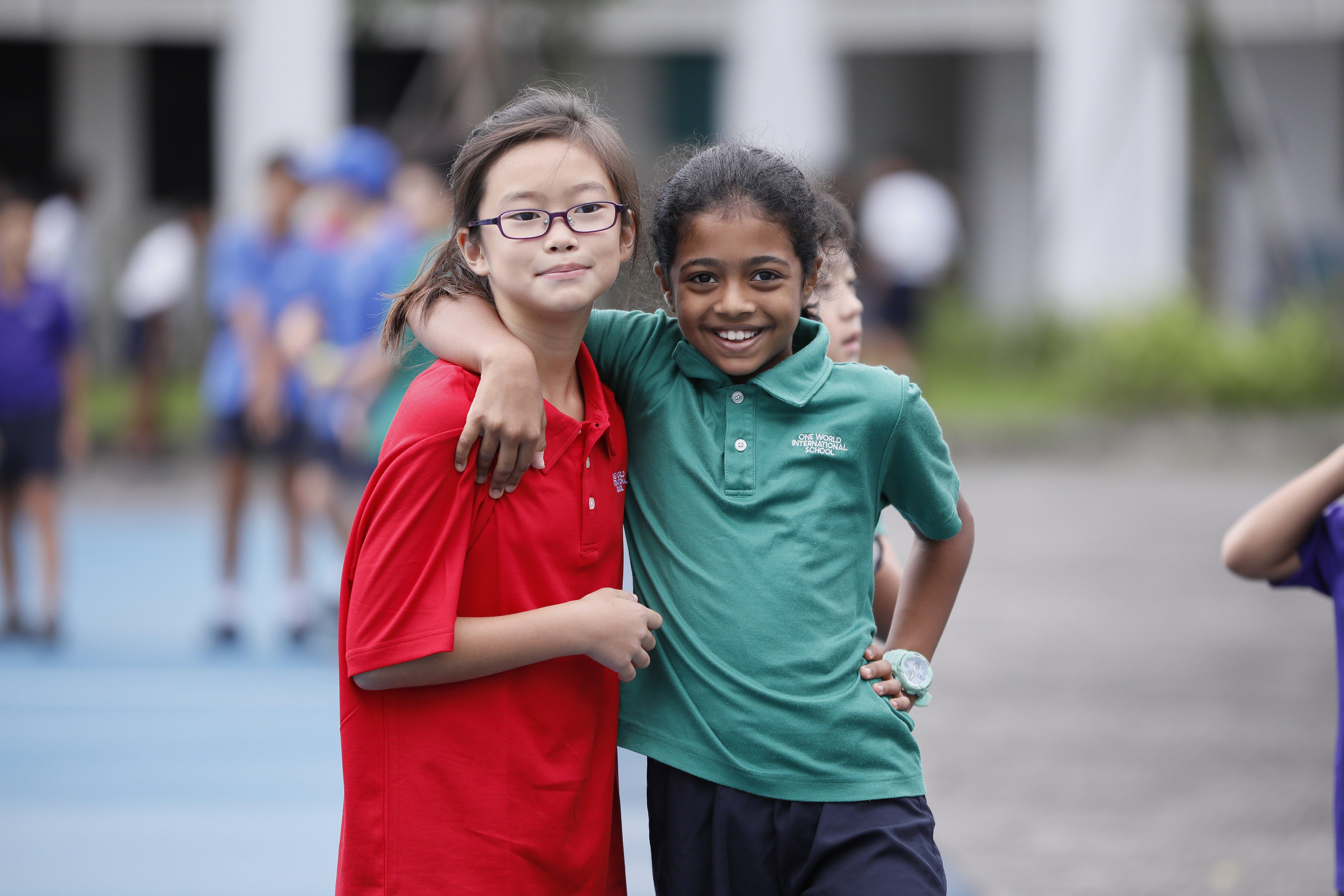 friends-posing-outside-of-school