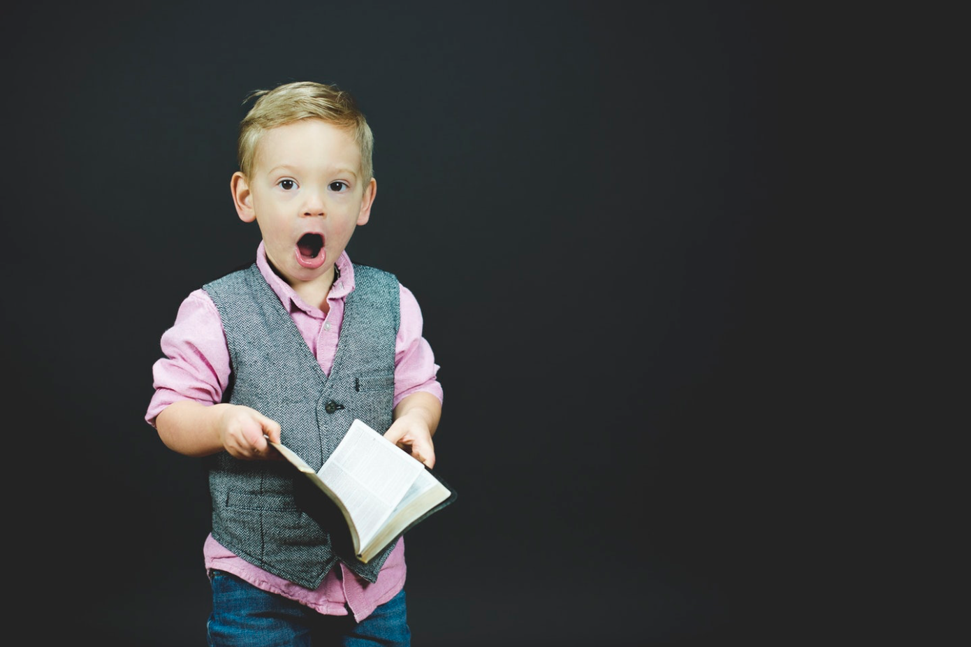 surprised-child-holding-book