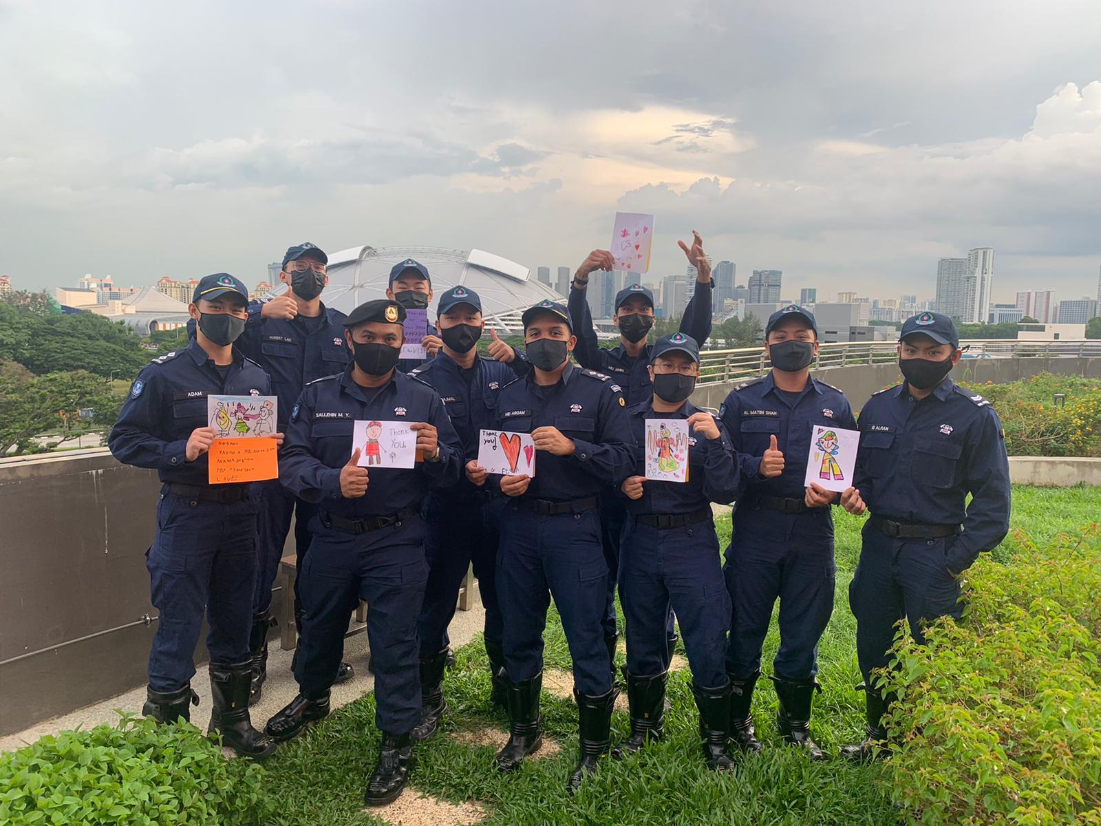 Firefighters with Appreciation Cards by OWIS Early Childhood Students