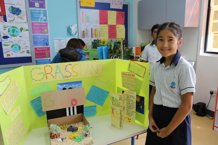 An OWISPrimary Student presents her work at the PYP Exhibition