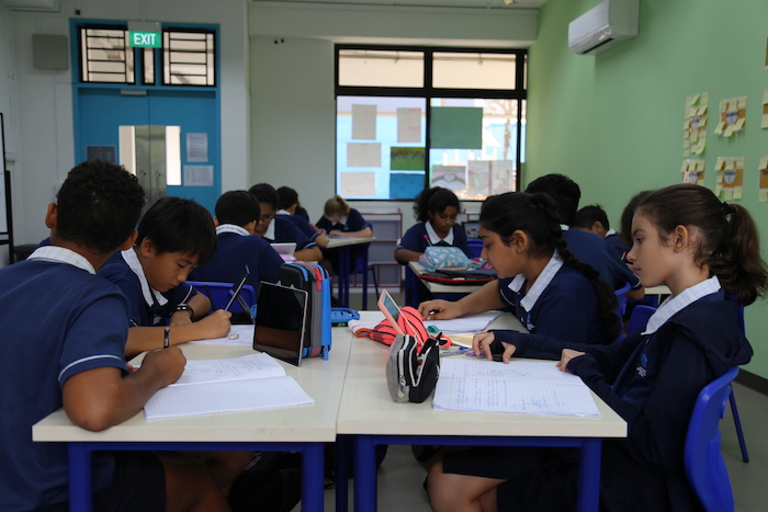 OWIS secondary students enjoy collaborative, inquiry-led learning, similar to IBPYP students