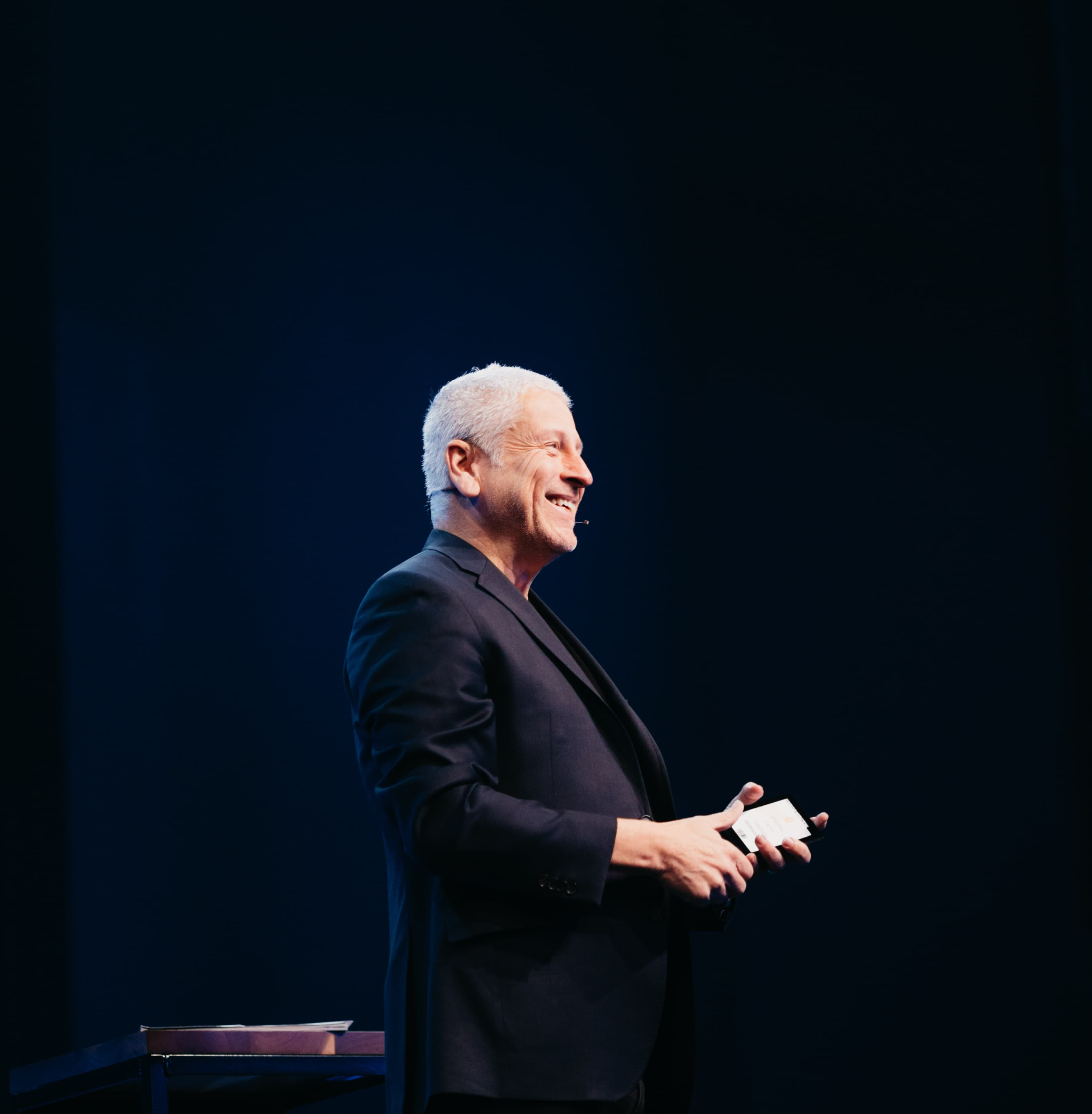 Louie Giglio standing on the Passion City stage giving a message.