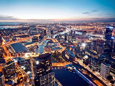 Aerial photo of Melbourne skyline at night.