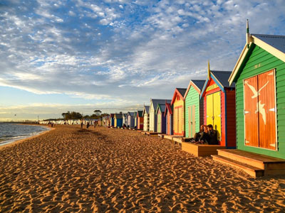 Colourful beach boxes on the beach.