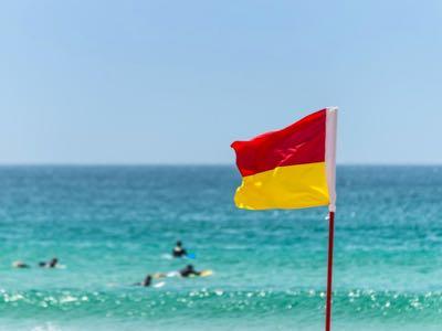 Surf lifesaver flag at the beach.