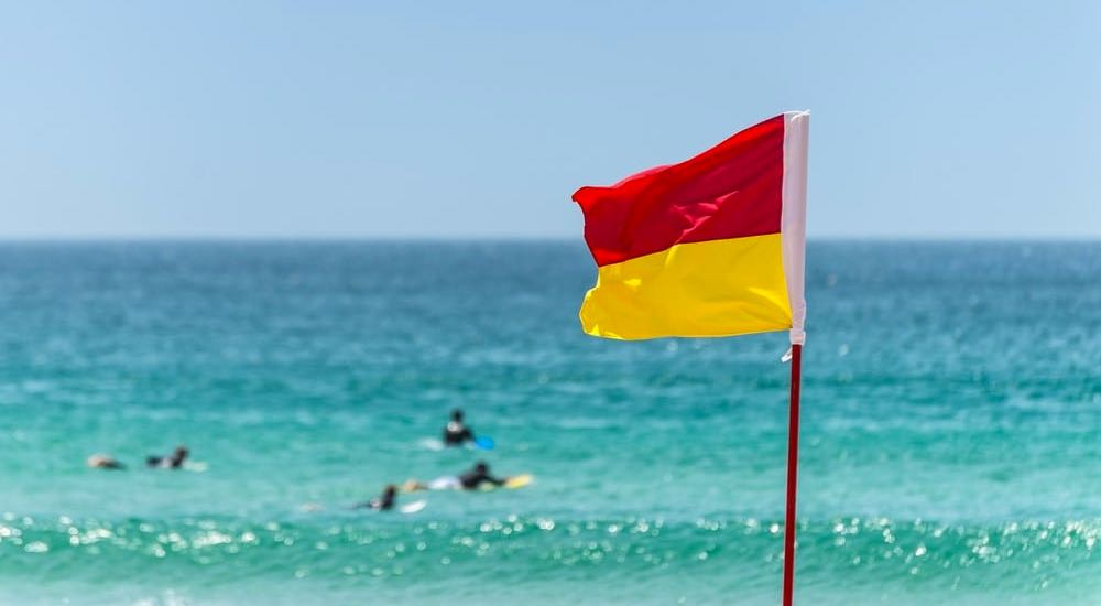 Surf lifesaver flag at the beach.