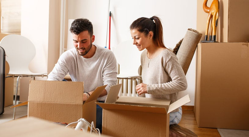 Couple Packing Their Belonging For International Removalist