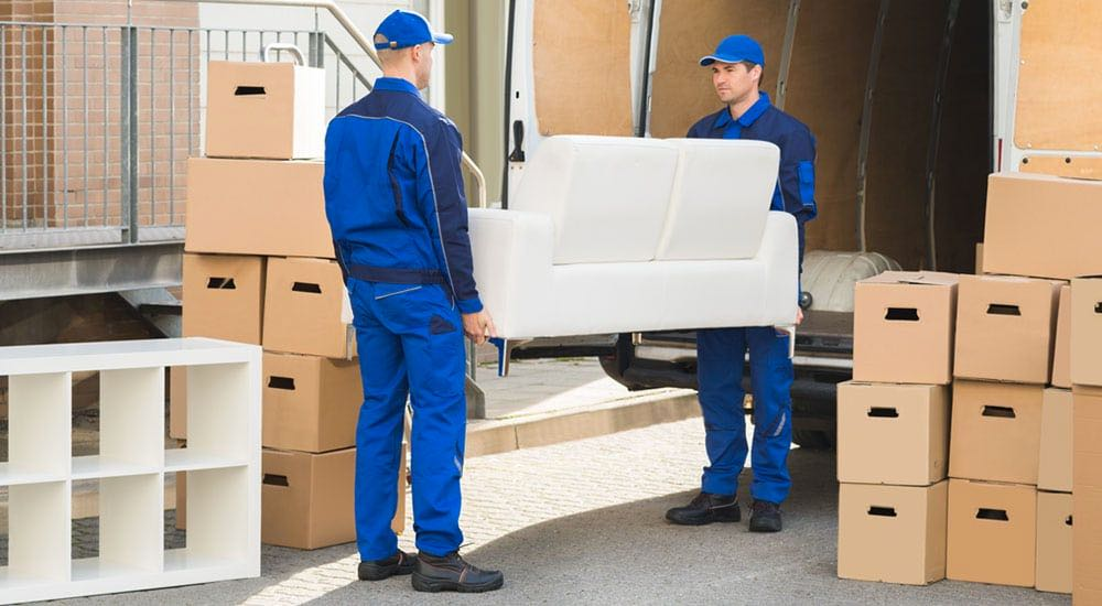 Removalists moving a couch