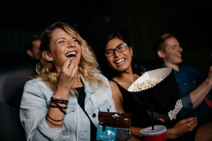 women enjoying cinema entertainment
