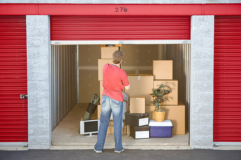 man finished putting stuff in storage