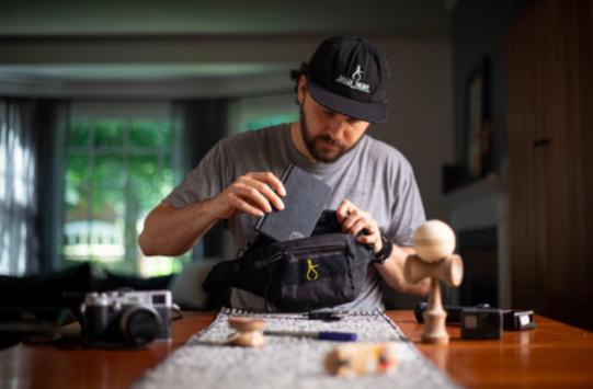 man filling newly designed bag