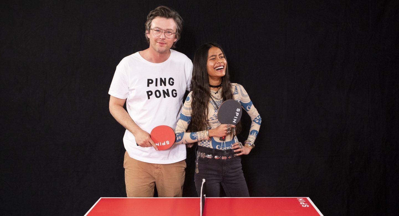 Arpana Rayamajhi and Jonathan Bricklin pose with ping pong paddles
