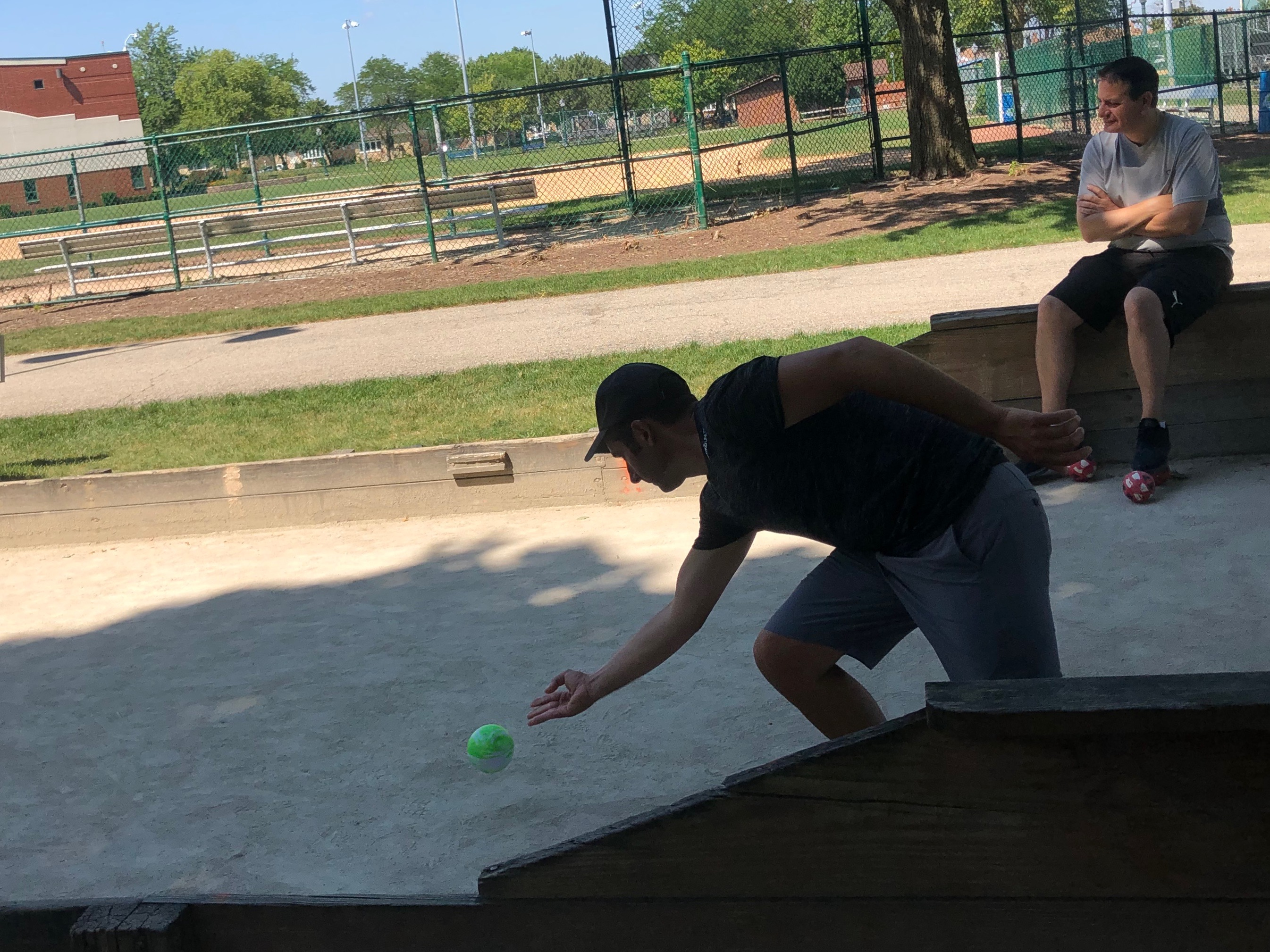 champion bocce player rolling ball