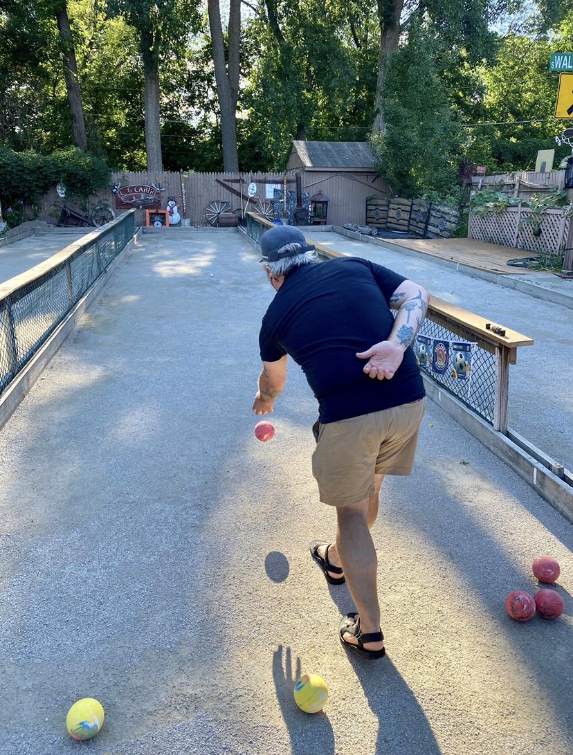 man throwing bocce ball