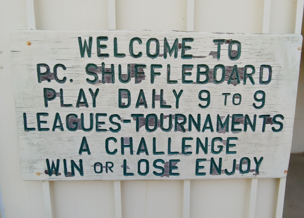 sign at shuffleboard club