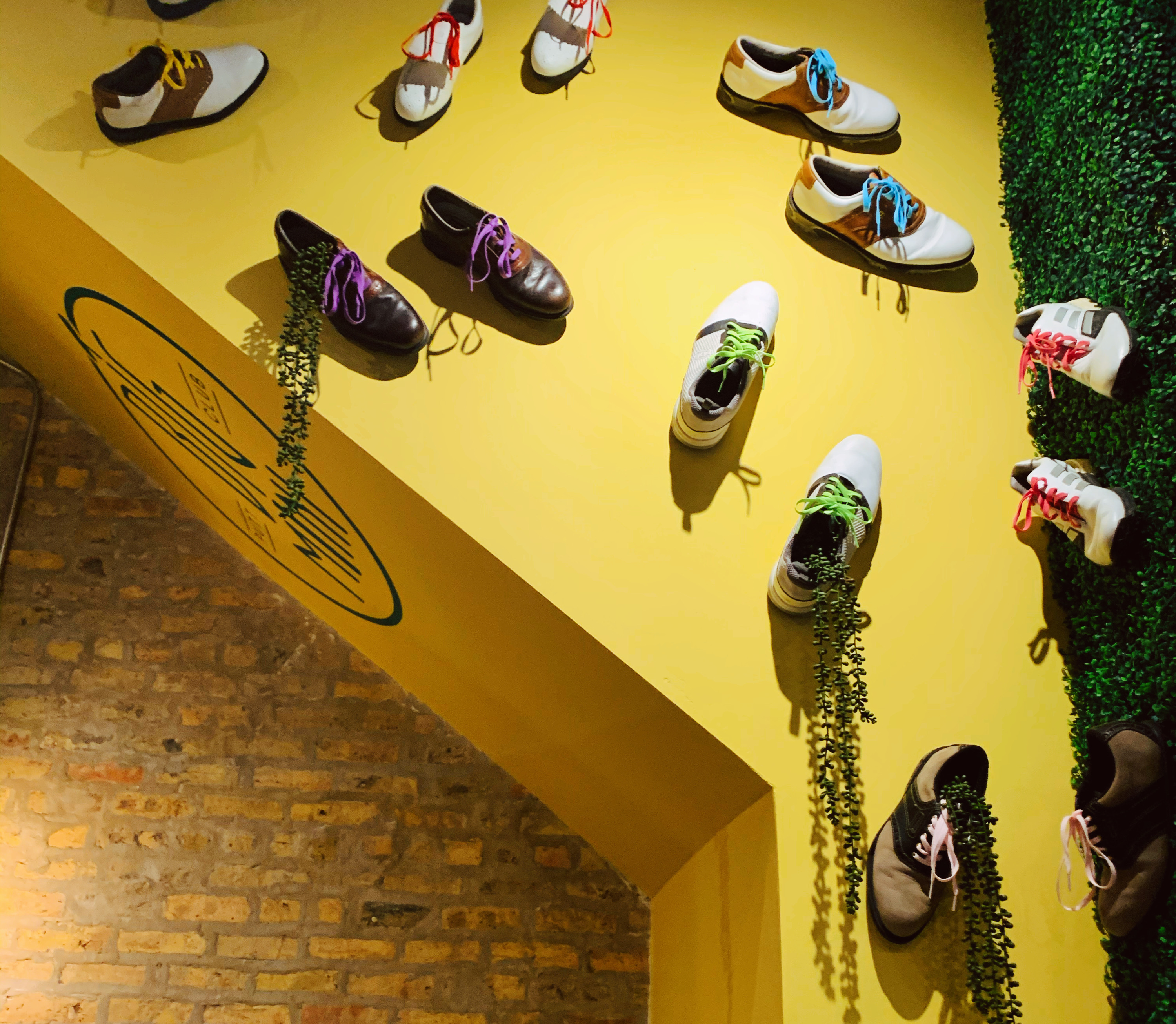 golf shoes on the wall