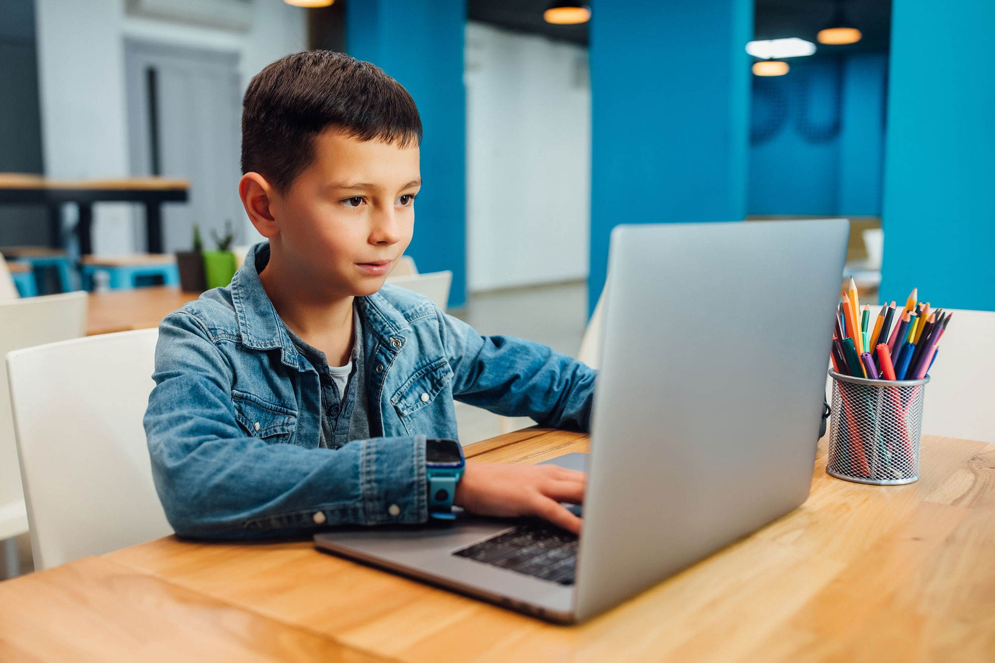 Boy typing in a computer