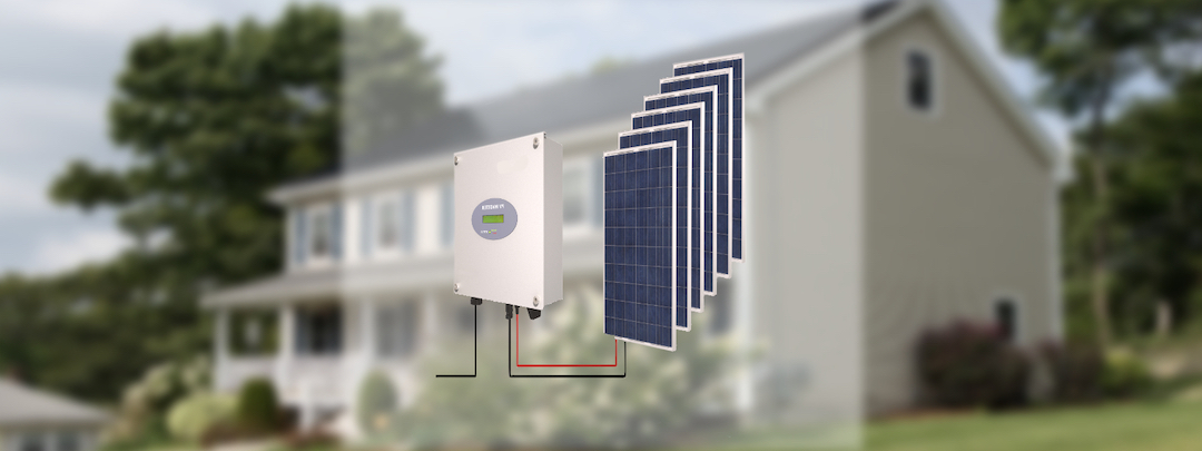 Ein Wechselrichter mit Solarpanels vor einem weißen Haus