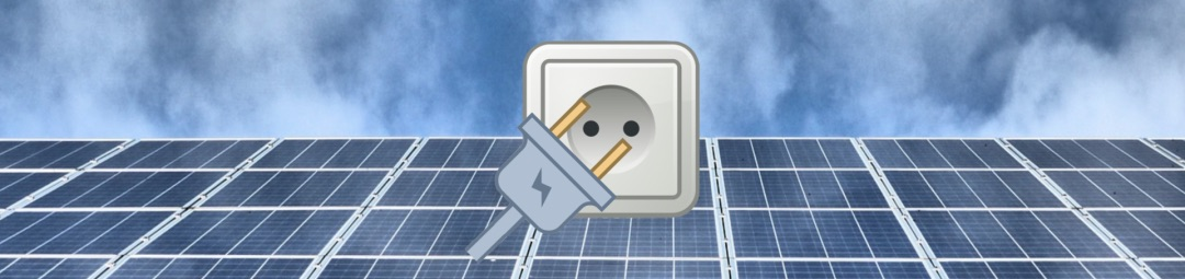 Eine graue Einspeiseanlage mit Stromstecker Symbol