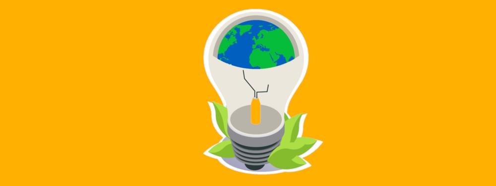 Eine grüne Glühbirne mit Blättern, die Ökostrom symboliseren