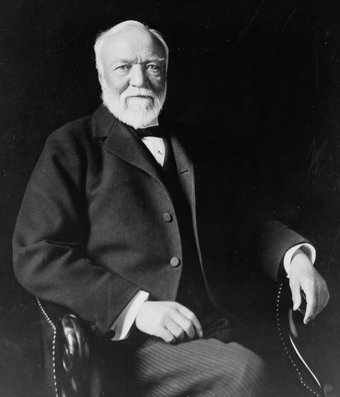 Andrew_Carnegie_three-quarter_length_portrait_seated_facing_slightly_left_1913.jpg