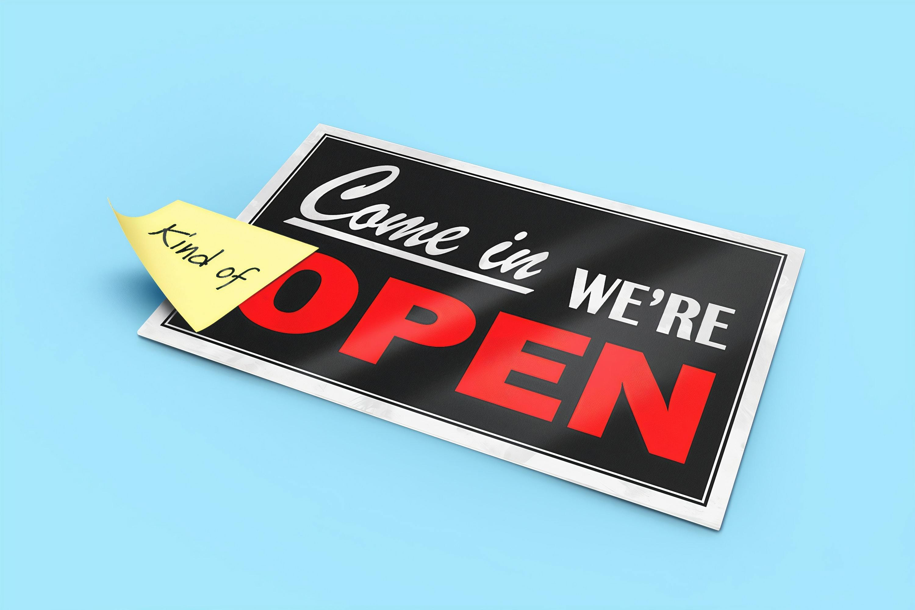 """A sign that reads, """"Come in, we're open""""."""