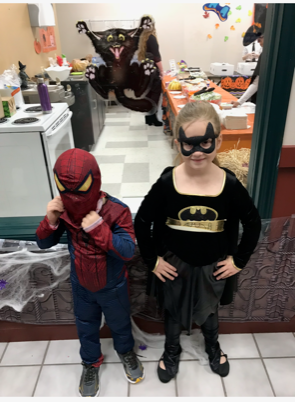 spiderman with his side kick bat woman