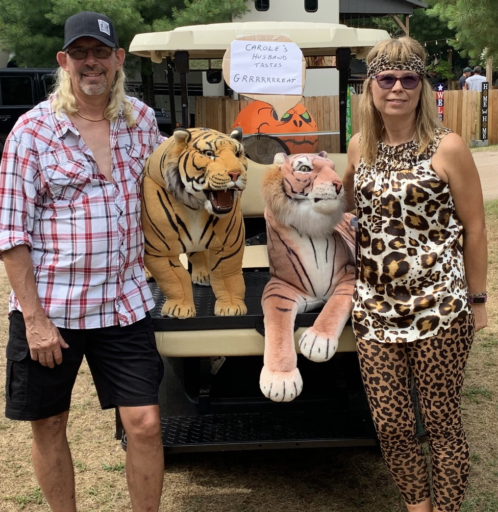Tiger King Joe Exotic and Carol Baskin with the Tigers
