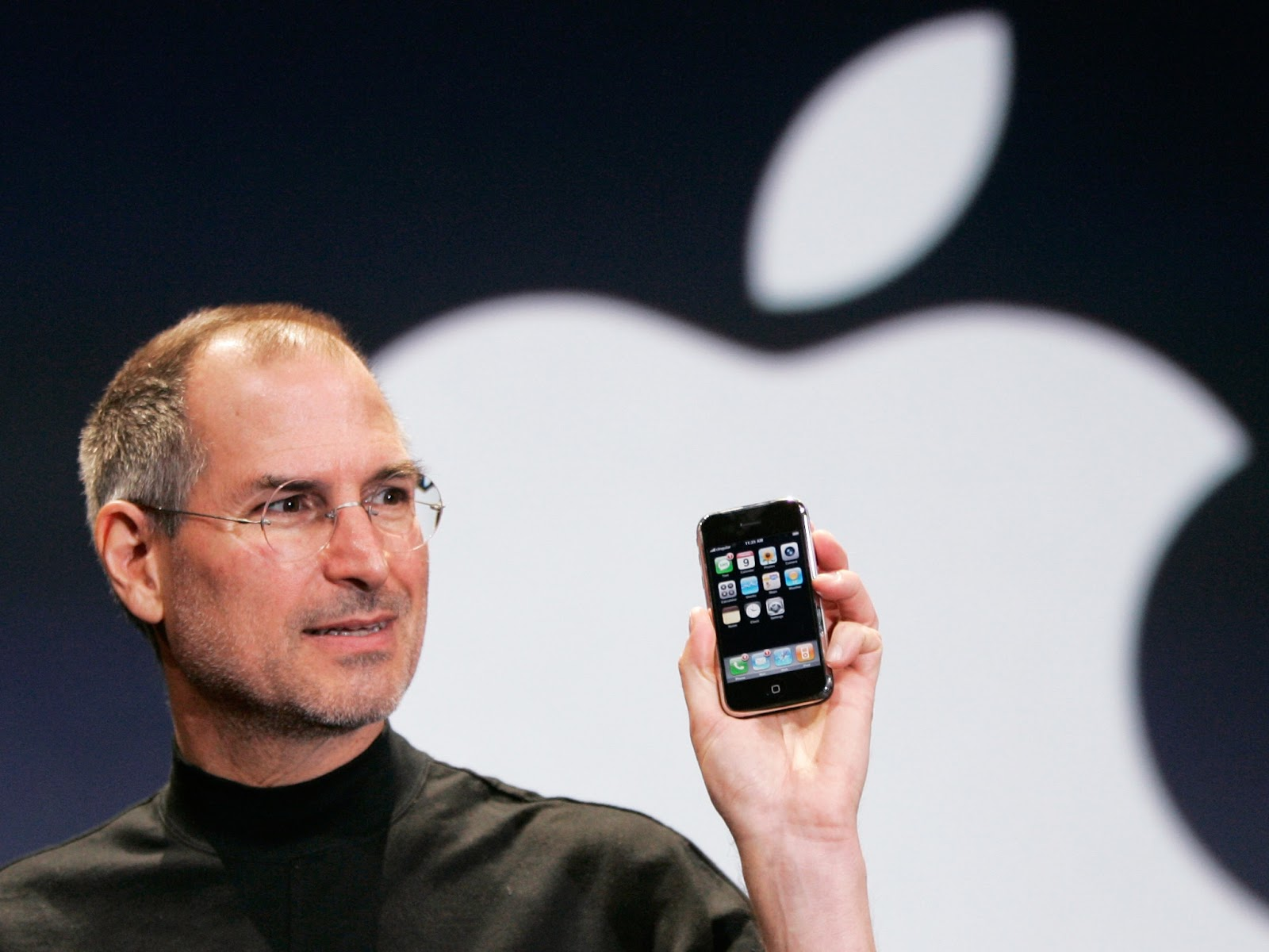 Image may contain Steve Jobs Cell Phone Electronics Mobile Phone Phone Human Person Glasses and Accessories