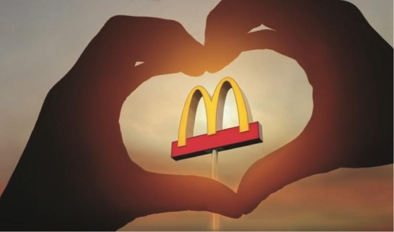 heart hands over mcdonald's sign