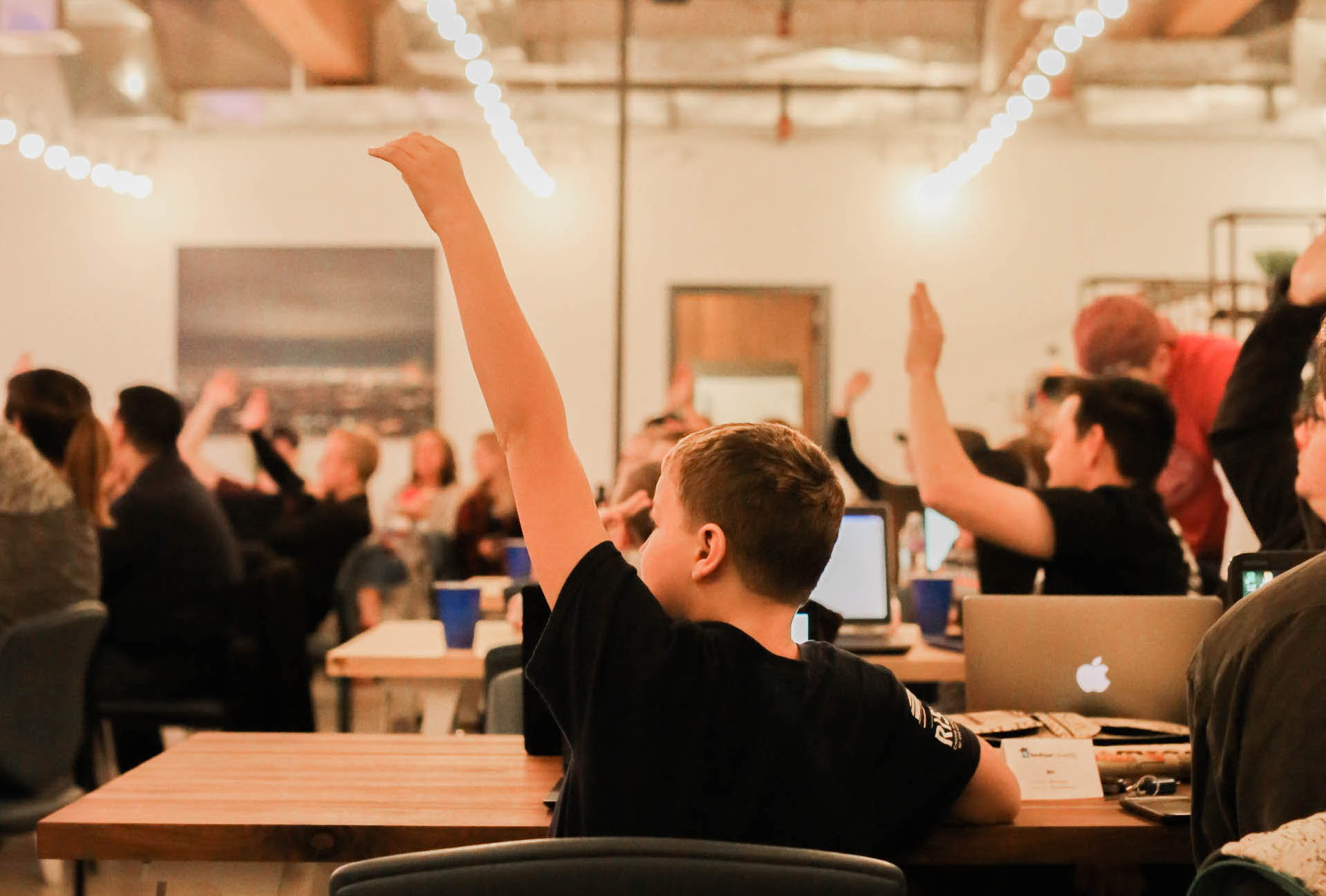 Student raising hand at a Skill Struck coding event