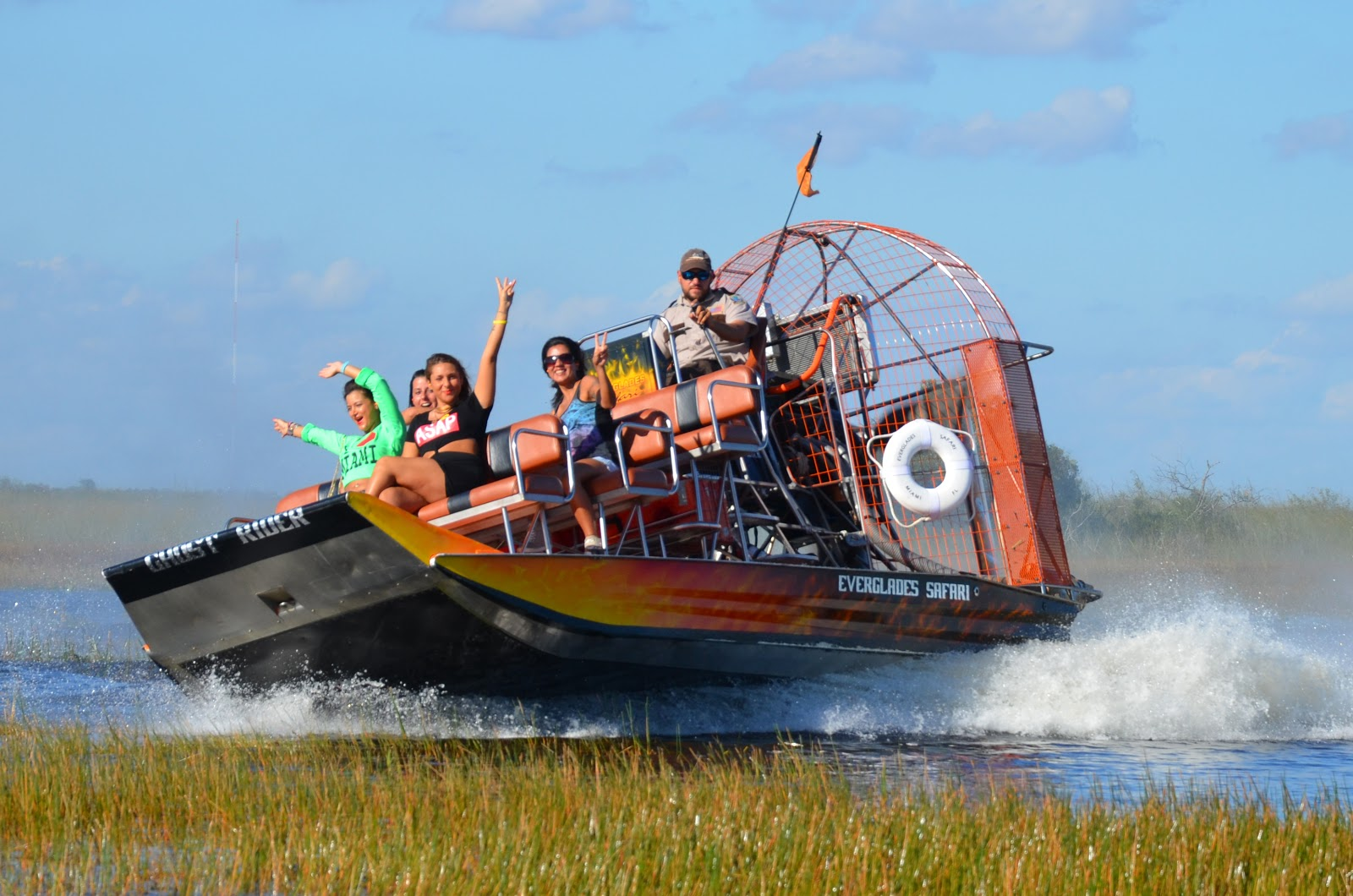 Visitors enjoying a thrilling ride on Everglades Safari Park Private National Park Airboat Tour.
