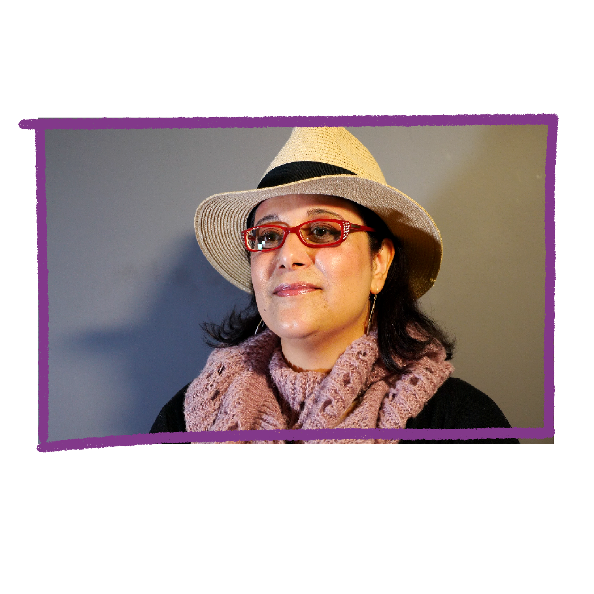 Photo of Talie. She is wearing a straw hat, pink scarf and glasses.