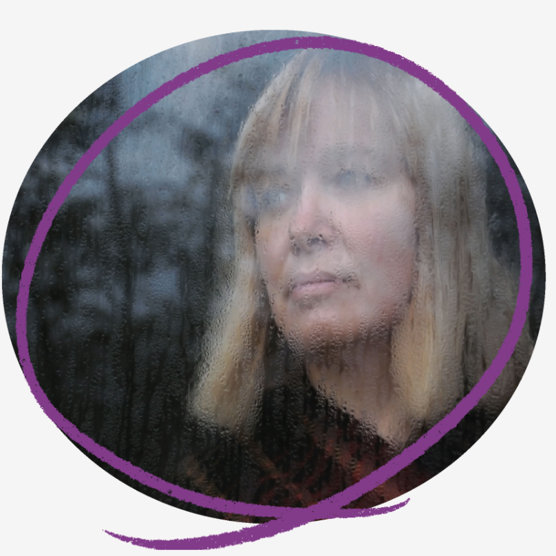 Photo of a woman with blonde bob length hair looking out of a perspired window.