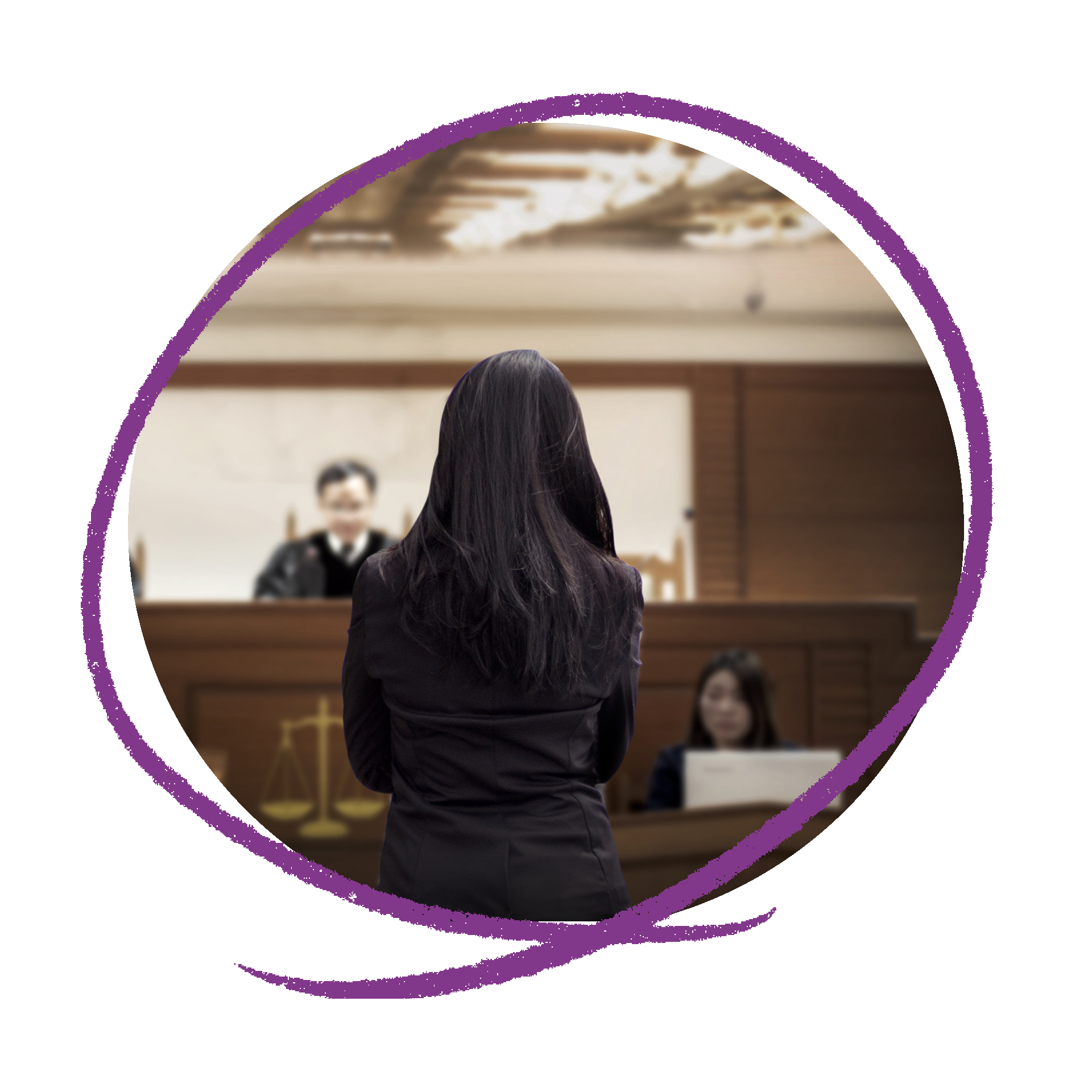 A woman with long dark hair standing up in court room looking towards a male judge.