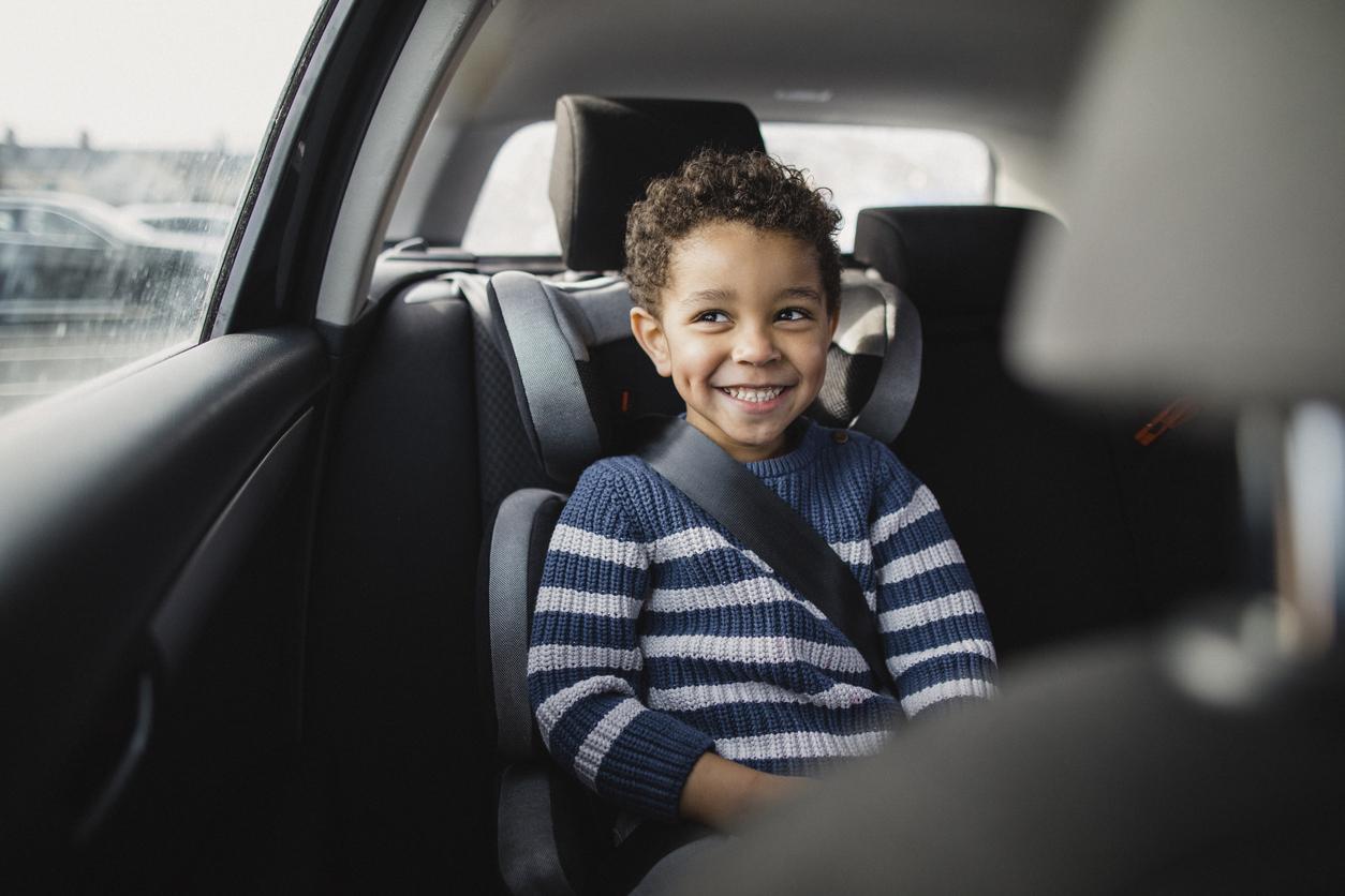 Happy child sitting a car seat