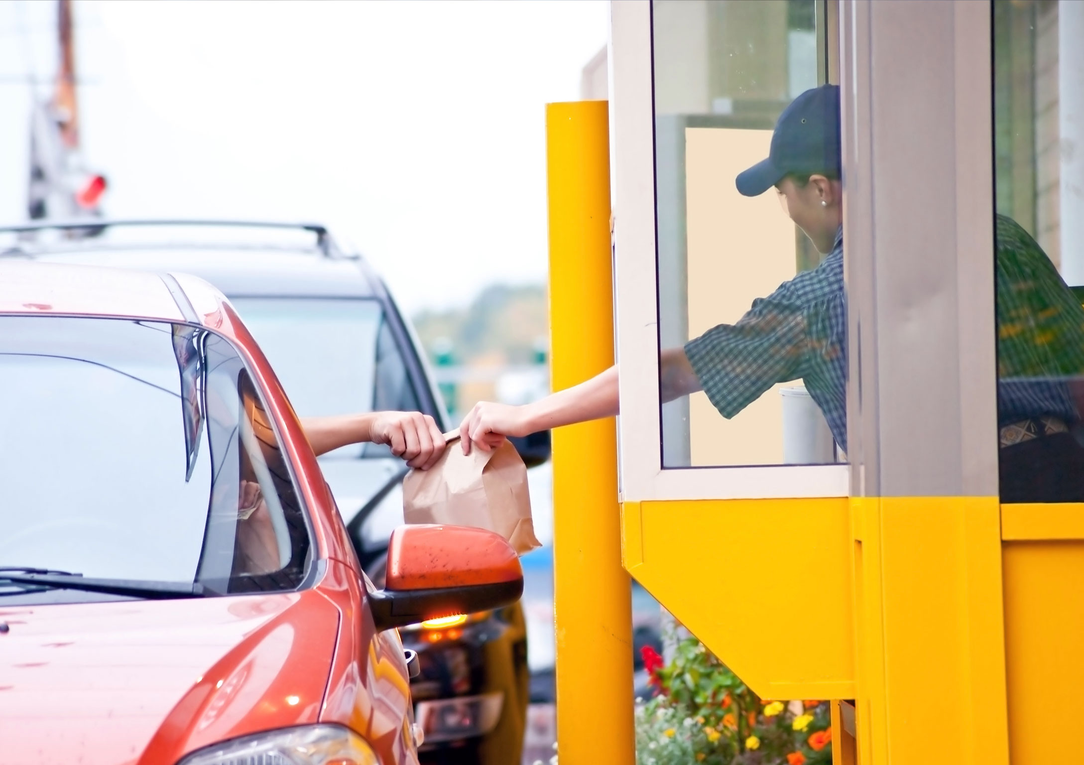 Handing someone food at drive thru