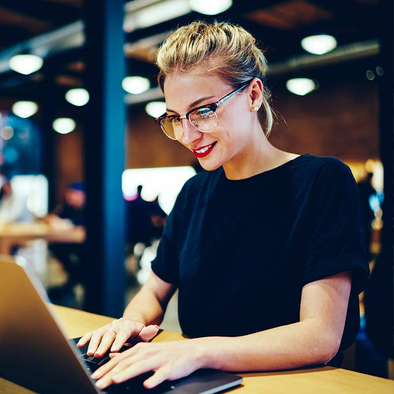 Woman signing up for service on laptop