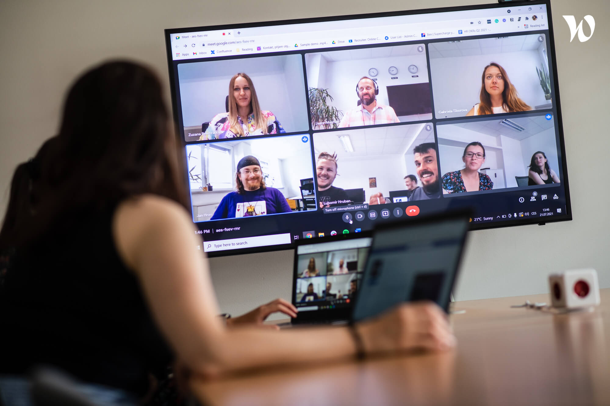 A photo of the Runecast team in a video call meeting.