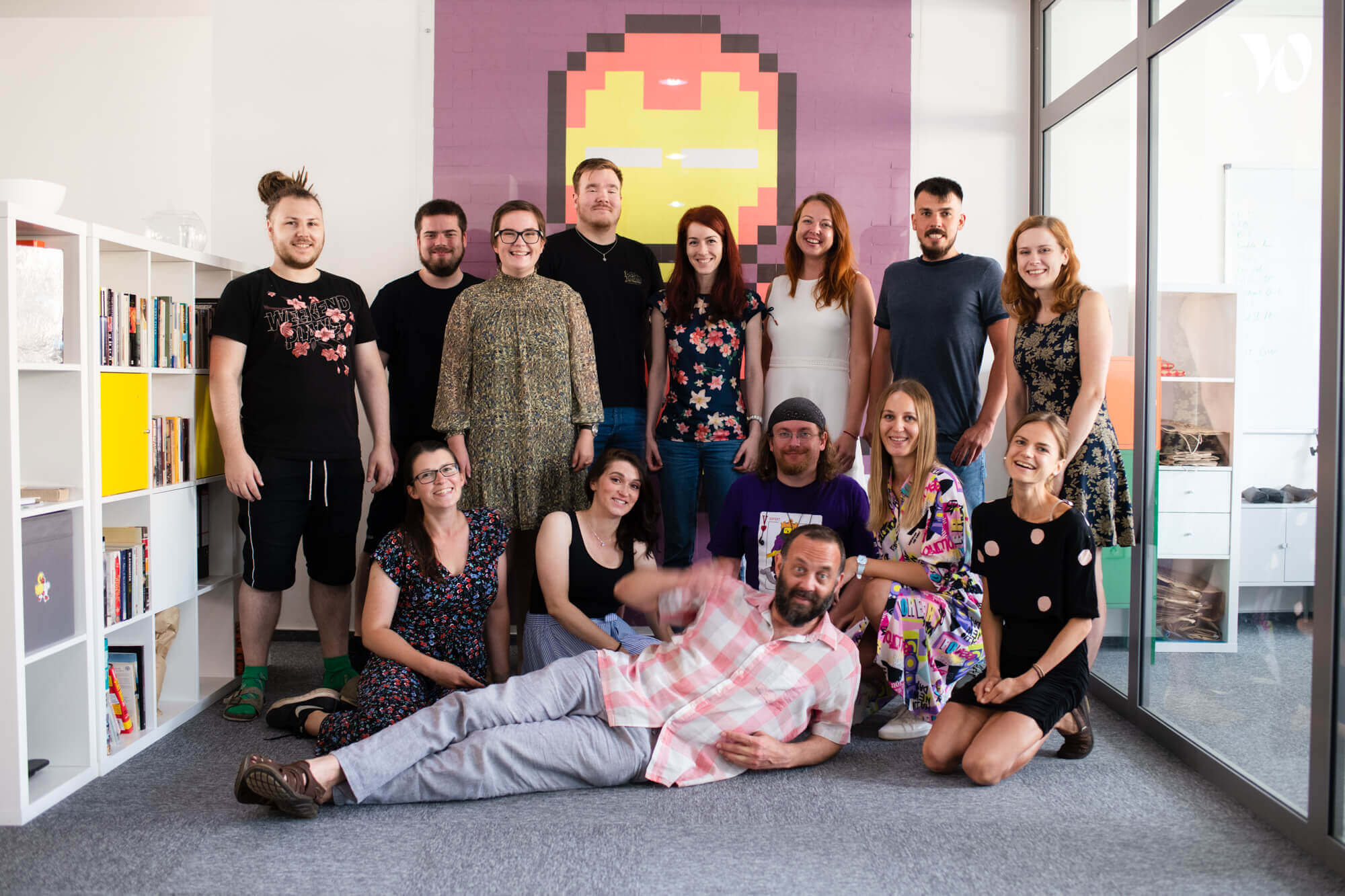 A photo of 14 members of the Runecast team at the Runecast offices in Brno.