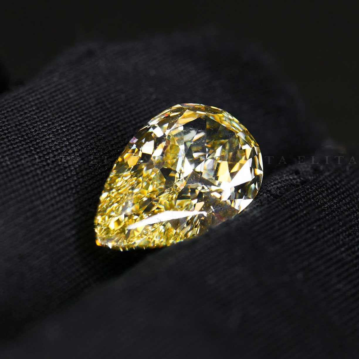 3.55ct Fancy Vivid Yellow Pear Modified Brilliant