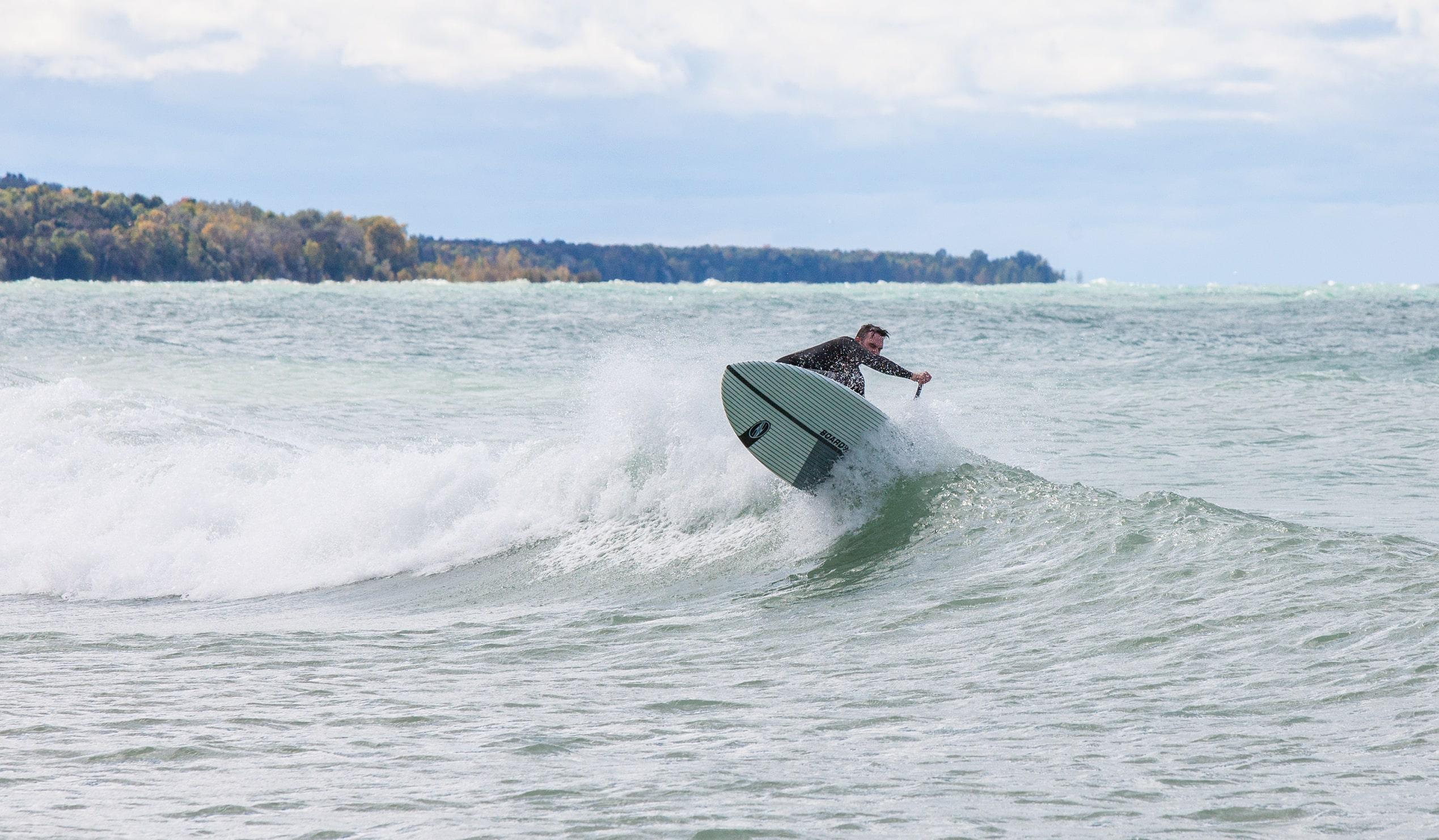 Man surfing on a lake