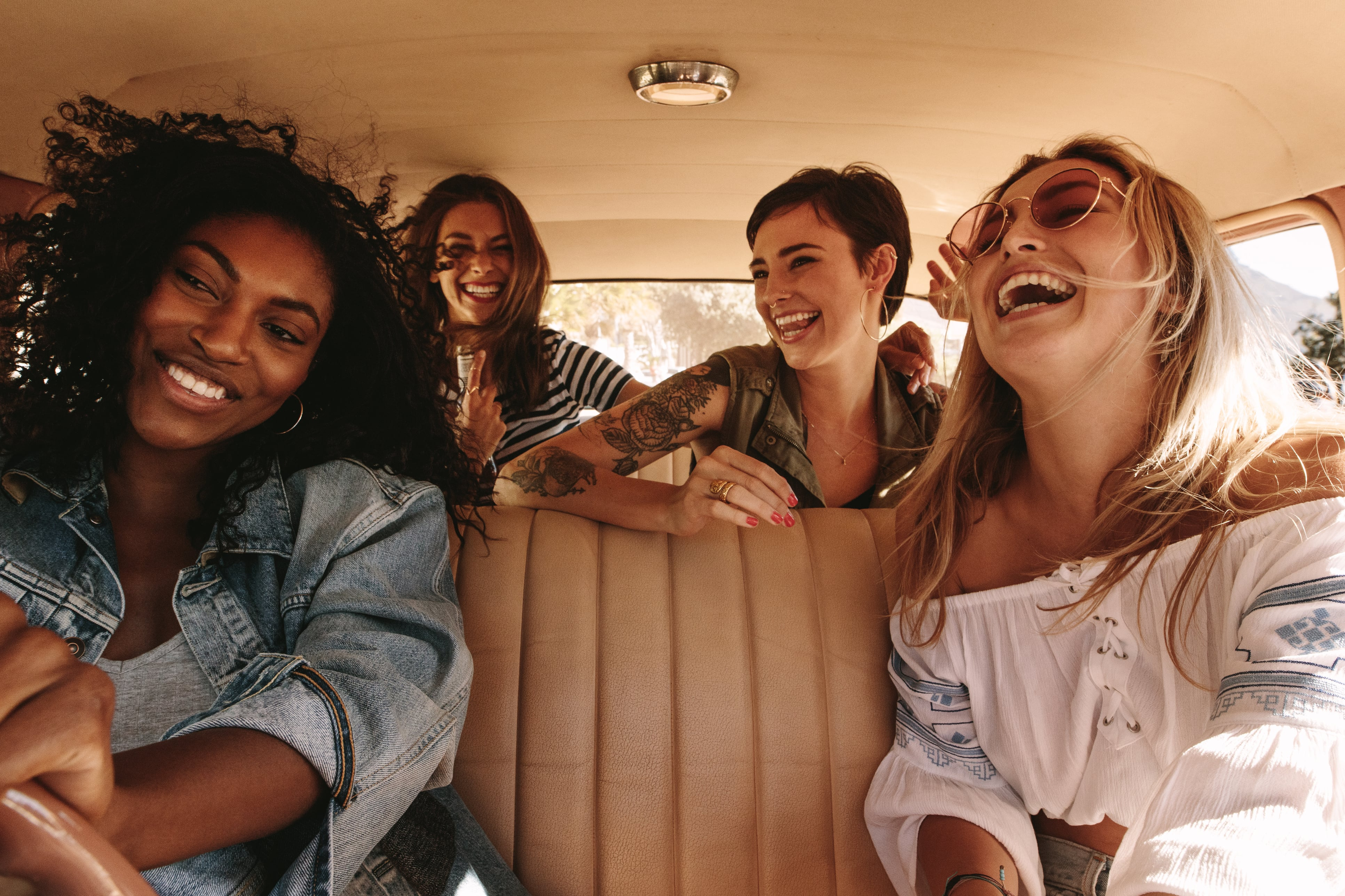 Young adults listening to music in a car